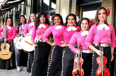 Members of the mariachi group pose.
