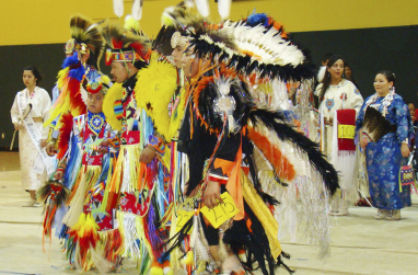Native dancers in regalia.