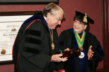 Retiring professor Nancy Warden jokes around with university president John Feaver.