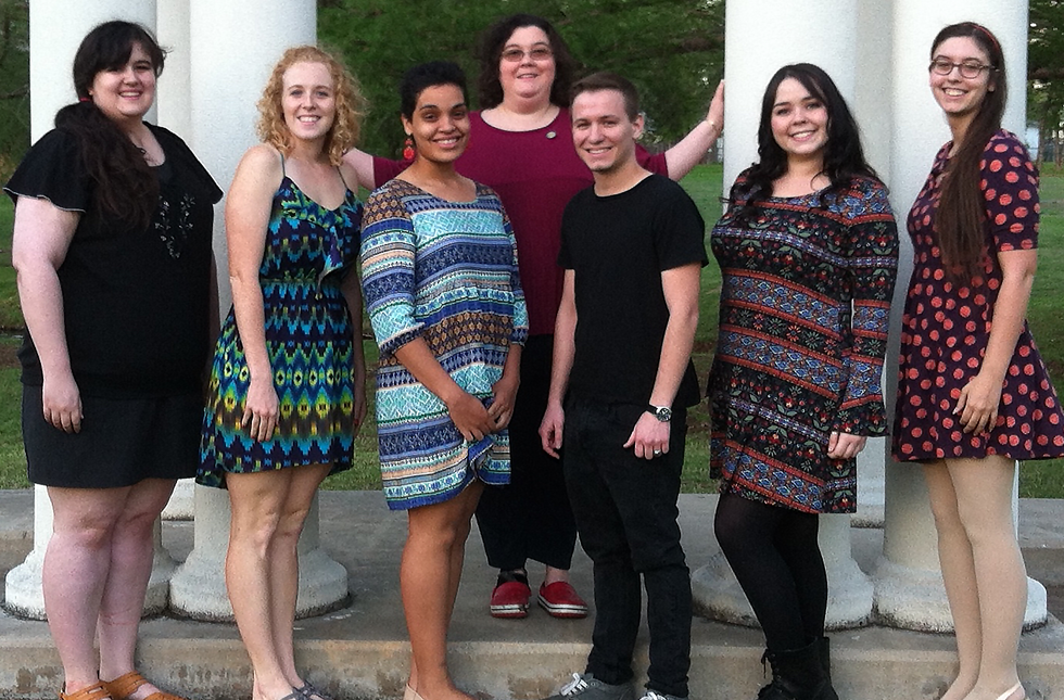 Theatre students pose with their sponsor in front of the Greek Theater.