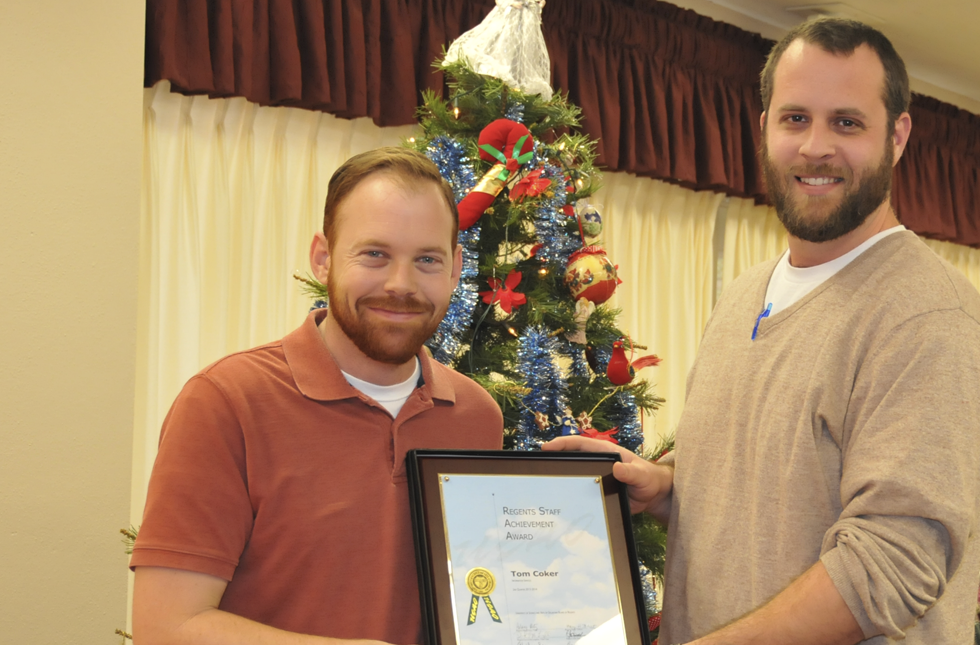 Tom Coker (left), computer technician at USAO, receives his Staff Achievement award from Adam Heilman, USAO Print Shop manager and the 2012-13 Employee of the Year.