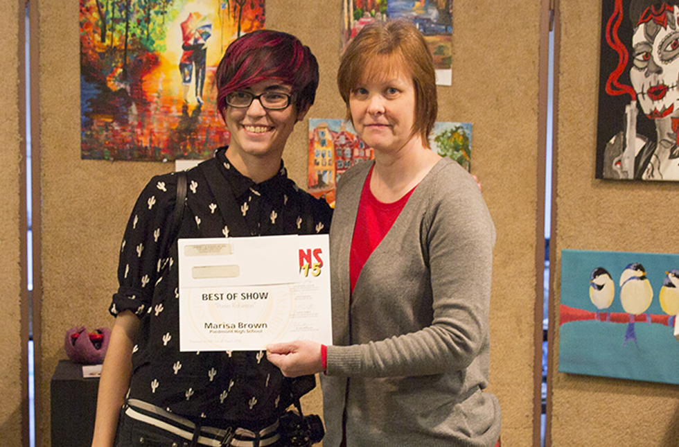 Piedmont's Marisa Brown posing with Jacquelyn Knapp, associate professor of art.