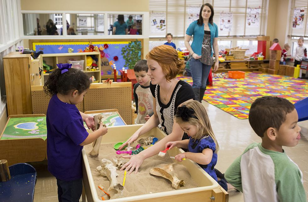 Picture of a USAO student working with children in the Child Development Center.