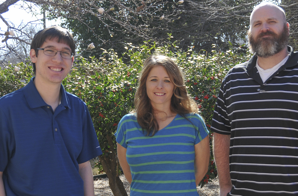 Kiefer Burkhard, Beth Powell and Dr. James Finck standing in the garden between Troutt and Austin Halls.