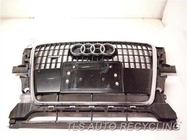 2009 Audi Q5 Audi Grille PASSENGER SIDE HAS SMALL CRACK, CHROME HAS MINOR ROCK CHIPS SLV,UPPER,ONE PIECE BUMPER ASSEMBLY