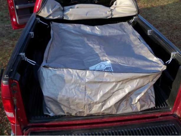 Weatherproof soft-sided cargo box for pickup trucks