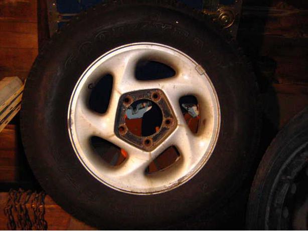 4 P205/75/R15 A/S Tires/Aluminum Mags