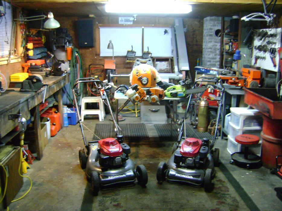 Lawnmower weedeater small engine repairs sidney north for Small motor repair shop