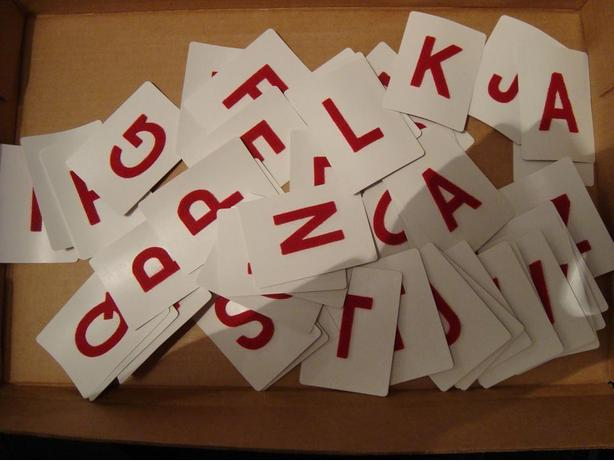 Playing cards with velvet letters and blank cards
