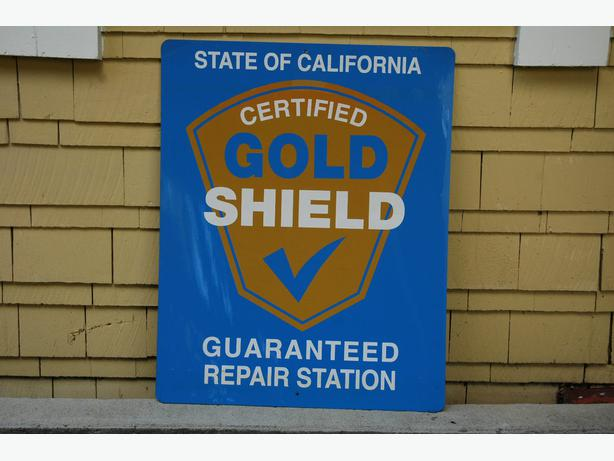 Metal Garage Sign - Gold Shield