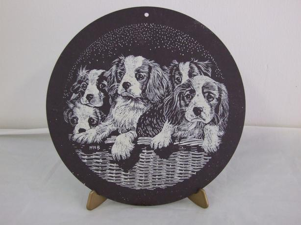 Five Spaniels in a Basket.