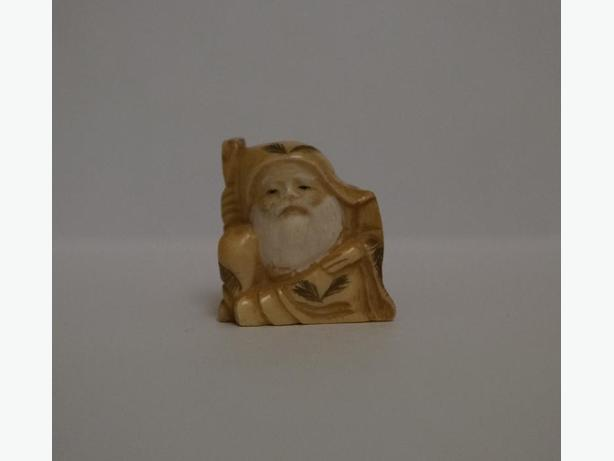 Carved Netsuke - Old Man with Stick.