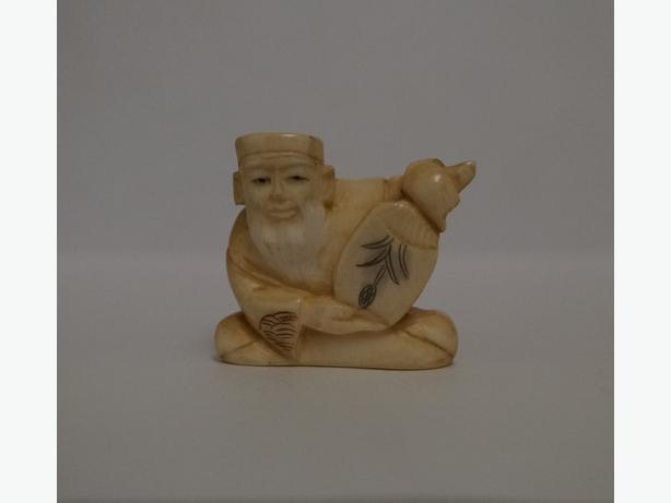 Carved Netsuke - Old Man with a Fan