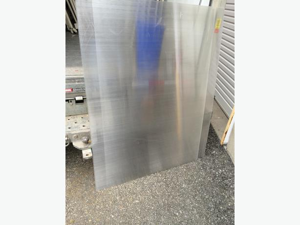 Corrugated plastic sheets, great for green houses etc