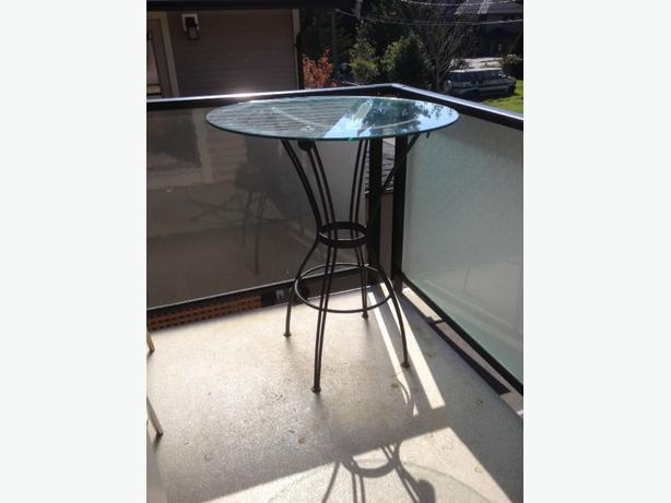 Cast iron glass top bistro table sooke victoria for Cast iron table with glass top