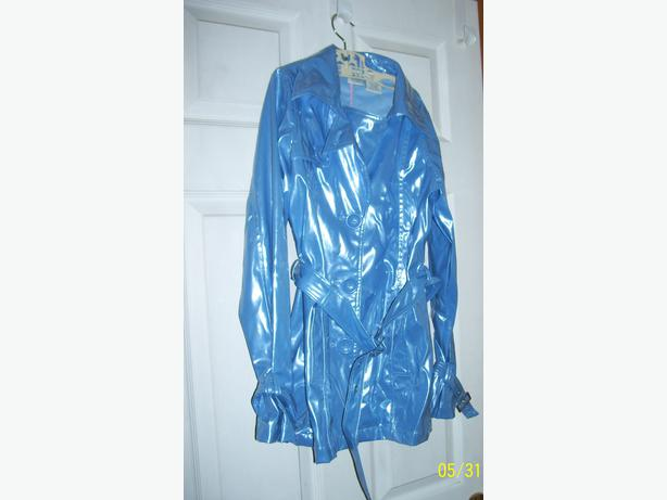 Girls size 14 raincoat  like new.