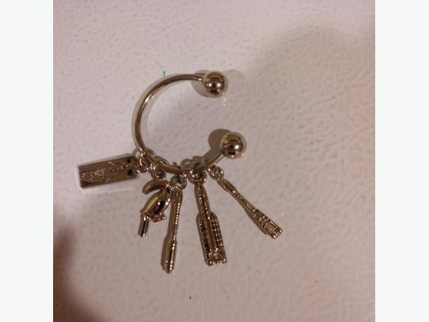 Key chain with small model rockets attached