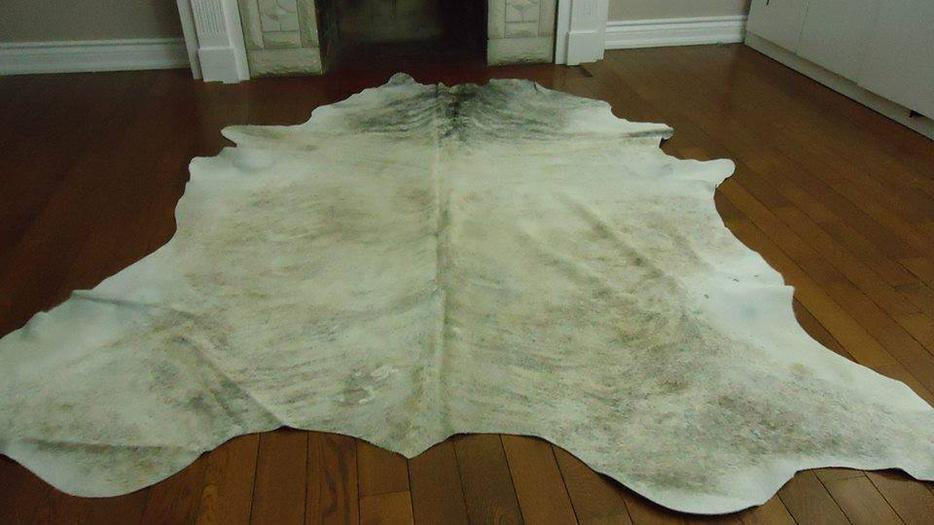 Cowhide rugs area rugs cowskin animal skin central for Cowhide rug houston
