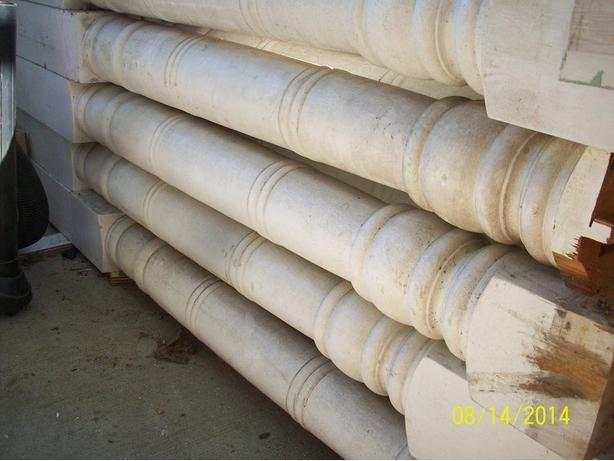 LARGE WOOD DECORATIVE COLUMNS USED.