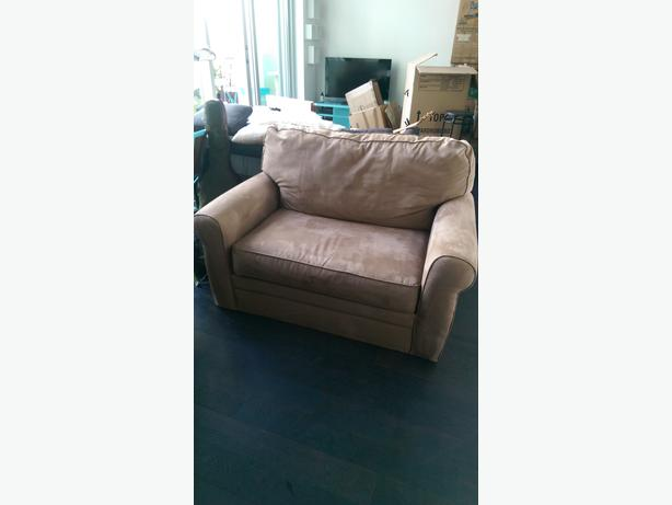 Huge and comfy beige chair and a half has a full single mattress when