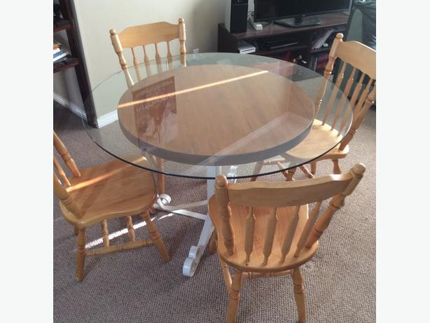 Obo glass top dining table with four chairs saanich victoria for Cast iron and glass dining table