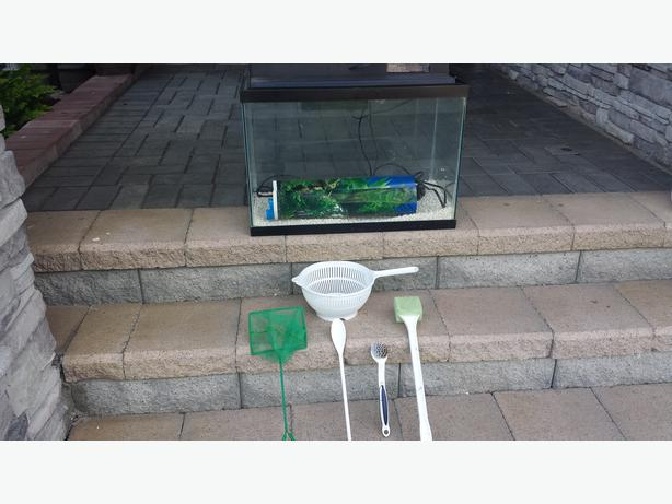 Fish tank & cleaning supplies , Good condition . Price Reduced.