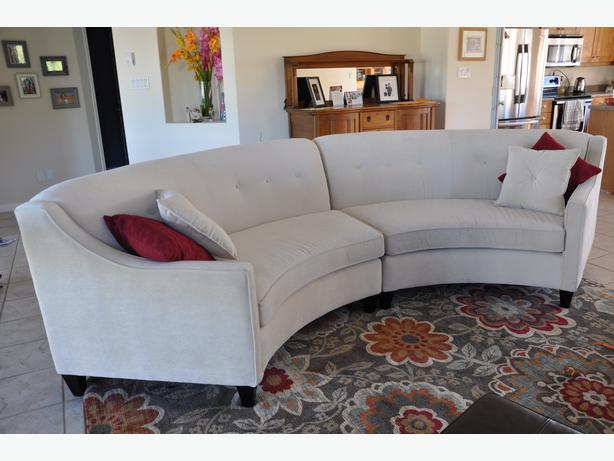 Ivory curved sectional rural regina regina for Furniture covers halifax