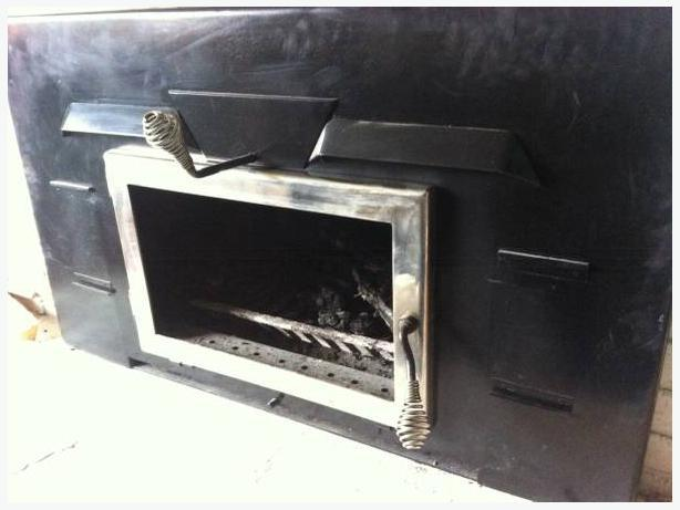beautiful restored fireplace cast iron insert with electric blower south nanaimo nanaimo. Black Bedroom Furniture Sets. Home Design Ideas