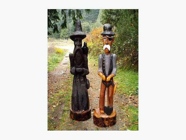 Chainsaw carved figures outside alberni valley