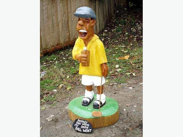 Carved Comedy Golfer