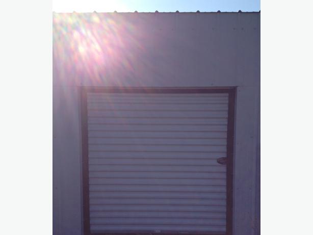 8ft x8ft x 12ft new metal building with 6ft x 6ft metal for 12 foot roll up door