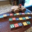 Wooded racing car with driver and wooden letter blocks
