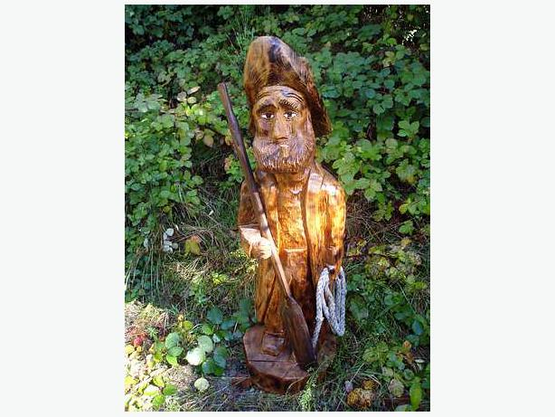 Chainsaw carved sea captain outside victoria