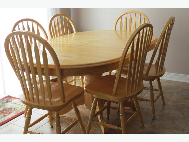 log in needed 400 solid maple dining table and 6 swivel chairs