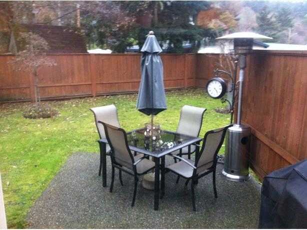 small patio table with 4 chairs umbrella and stand