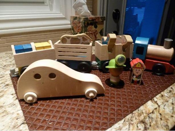 Wooden farm train set and wooden car  $25