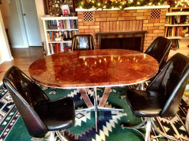 mad men era style kitchen table with four matching black faux leather
