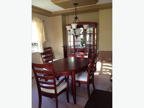 cherry wood table with six chairs plus buffet and hutch in great
