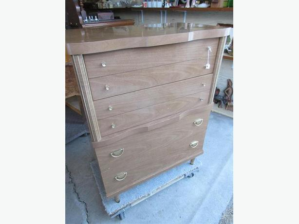 ESTATE FOUR DRAWER WOODGRAIN CHEST OF DRAWERS