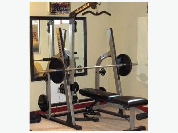 Nautilus squat rack lat tower adjust bench inch weights