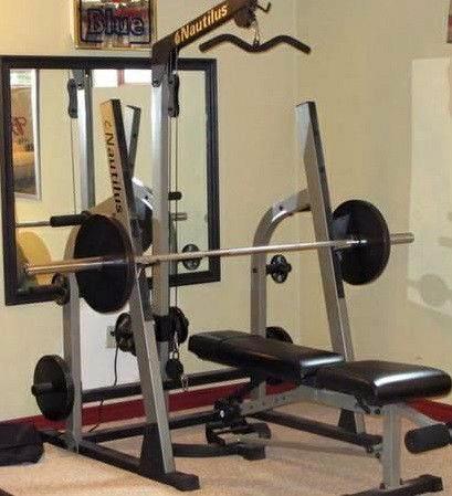 Nautilus Squat Rack Lat Tower Adjust Bench 1inch Weights