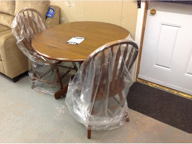 Brand new 3 piece dining set with side leaf! Taxes in.