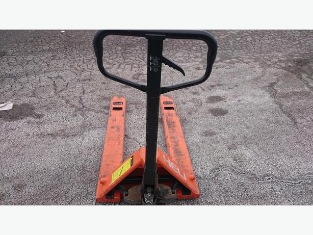 "PALLET PUMP TRUCK - USED, 5500 POUNDS, 27"" X 48"", GOOD CONDITION"