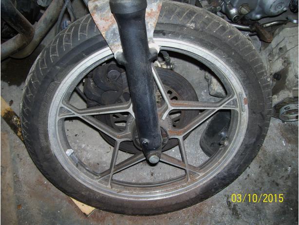 Suzuki GS400 front wheel rim Bridgestone tire brake rotor disc