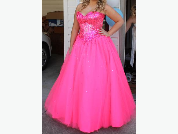 Hot pink grad dress. Worn once. Bought from Ladybelle Bridal for $800.
