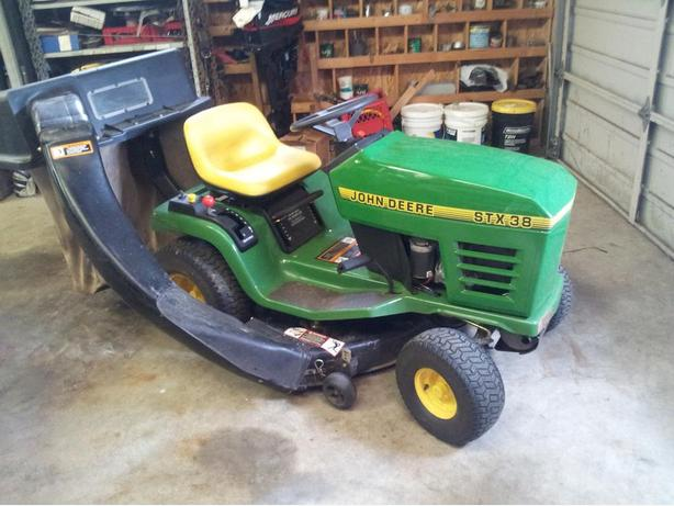 John Deere Stx38 Riding Lawn Mower With Dual Bags Outside