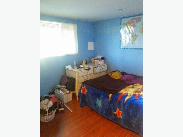 2 bedroom den lower level suite in cinnabar south for 2 bedroom with den