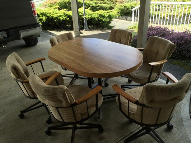 like new kitchen table and 6 rolling captains rips or stains