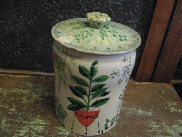 Retro toffee tin with 1950's house plant decor scenes