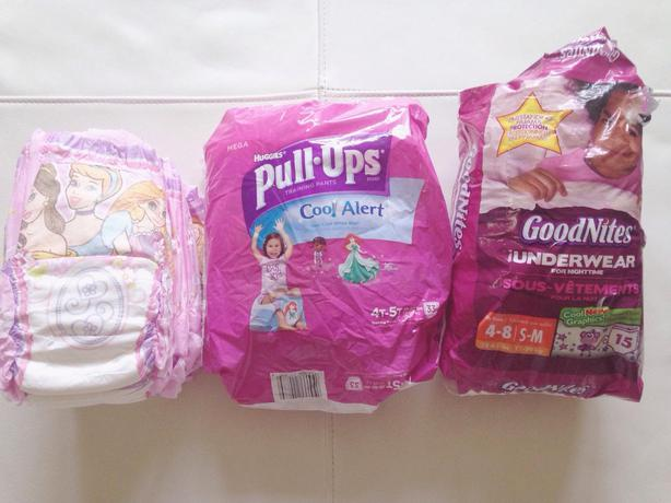 Assortment of pull ups, night time diapers, huggies ...